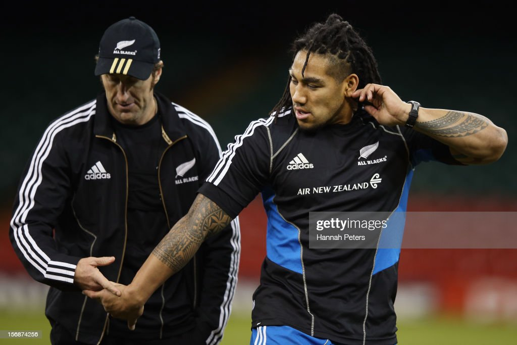 All Blacks Strength and Conditioning Coach Nic Gill shakes hands with Ma'a Nonu during a captain's run at Millennium Stadium on November 23, 2012 in Cardiff, Wales.