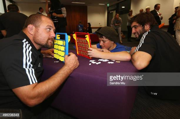 All Blacks Tony Woodcock and Sam Whitelock play 'Guess Who' with Connor Lehan who lives with Asperger's syndrome during the New Zealand All Blacks...