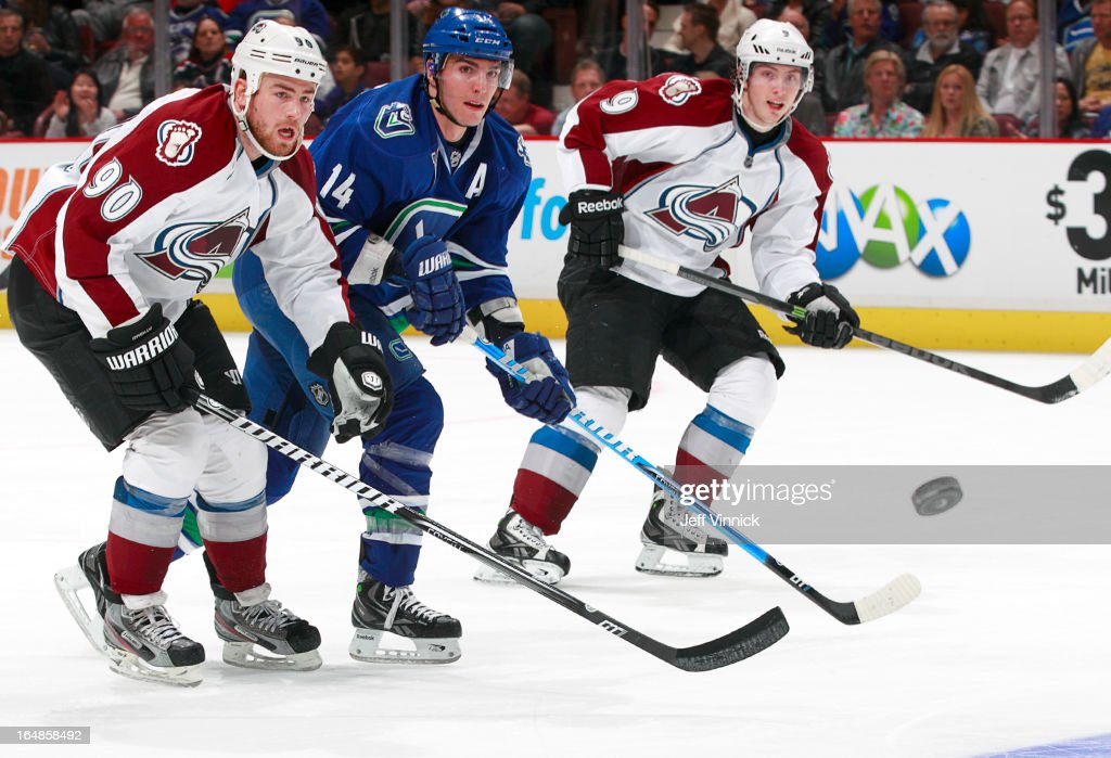 All eyes on the puck belong to <a gi-track='captionPersonalityLinkClicked' href=/galleries/search?phrase=Alexandre+Burrows&family=editorial&specificpeople=592489 ng-click='$event.stopPropagation()'>Alexandre Burrows</a> #14 of the Vancouver Canucks, <a gi-track='captionPersonalityLinkClicked' href=/galleries/search?phrase=Ryan+O%27Reilly&family=editorial&specificpeople=4754037 ng-click='$event.stopPropagation()'>Ryan O'Reilly</a> #90 and <a gi-track='captionPersonalityLinkClicked' href=/galleries/search?phrase=Matt+Duchene&family=editorial&specificpeople=4819304 ng-click='$event.stopPropagation()'>Matt Duchene</a> #9 of the Colorado Avalanche during their NHL game at Rogers Arena March 28, 2013 in Vancouver, British Columbia, Canada. Vancouver won 4-1.