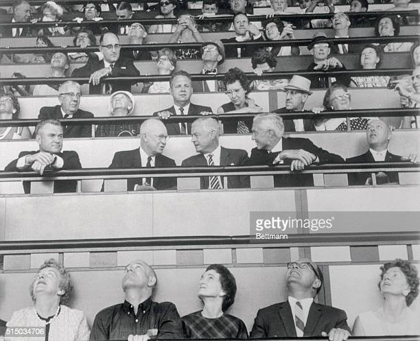 All eyes seem to point to former President Dwight D Eisenhower as he visits the IBM pavilion Seated with the former Chief Executive are Dean R McKay...