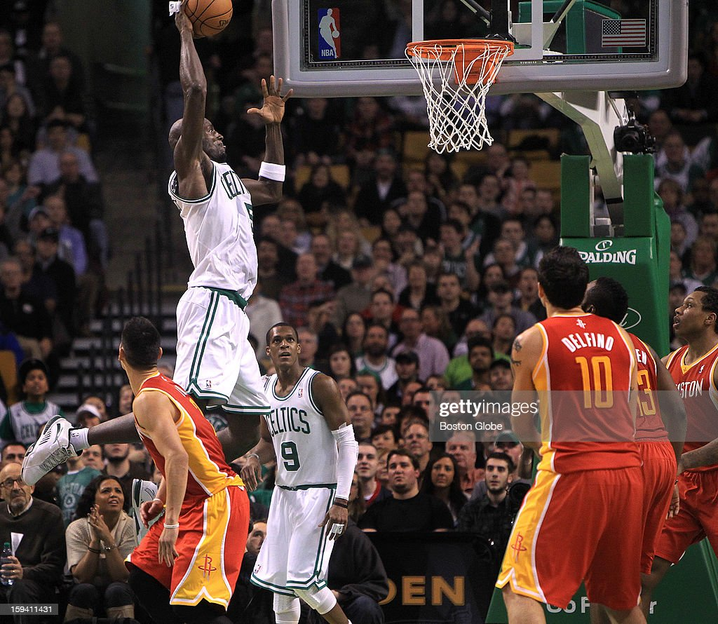 All eyes were on Boston Celtics power forward Kevin Garnett (#5) as he took to the air for a slam dunk in the fourth quarter giving the Celtics a 98-84 lead with 3:06 left to play as the Boston Celtics play the Houston Rockets at TD Garden.