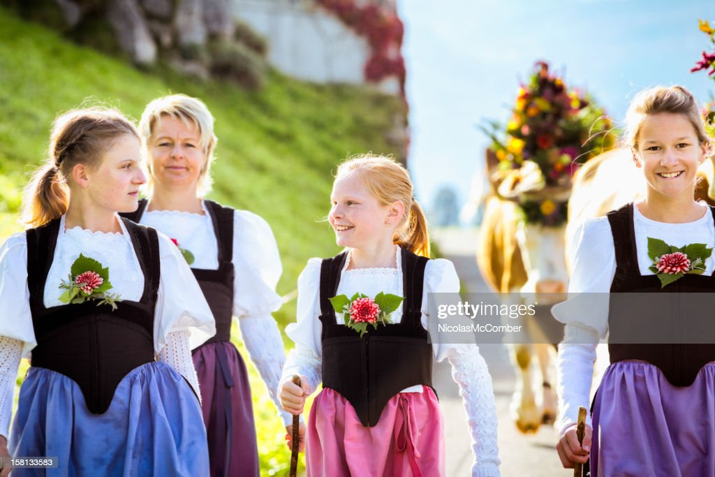 All Female farmer family leading cows to traditional fair : Stock Photo