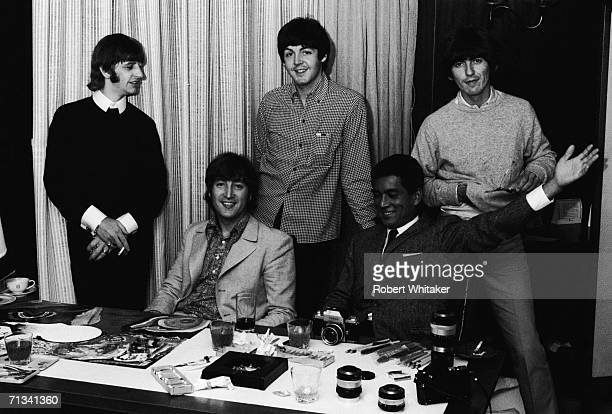 All four Beatles and a Japanese guest relax in their Tokyo Hilton suite Japan 1966