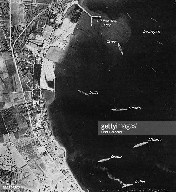 All her eggs in one basketl All six of italy's battleships are shown safely at anchor in the outer harbour at Taranto' from 'East of Malta West of...