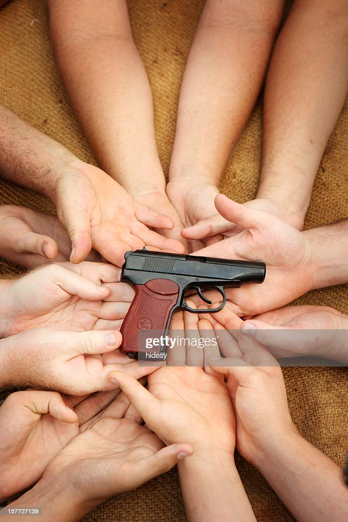 All holding weapon : Stock Photo