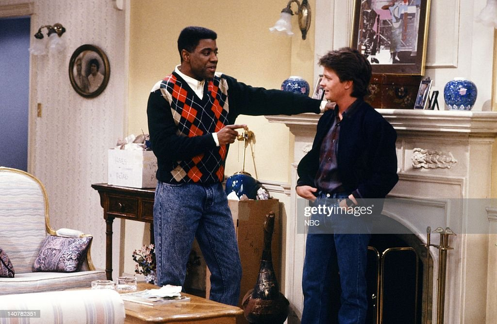 TIES 'All in the Neighborhood Part 1' Episode 17 Pictured Keith Amos as Michael Thompson Michael J Fox as Alex P Keaton Photo by NBC/NBCU Photo Bank