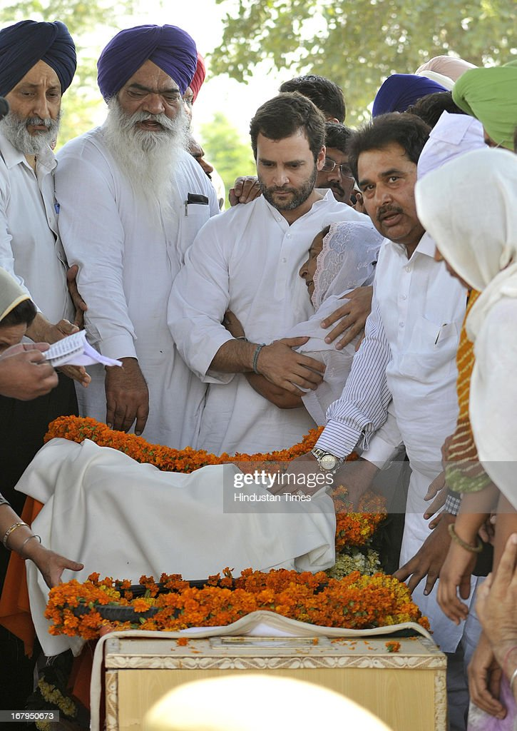 All India Congress Committee Vice President Rahul Gandhi consoling the Indian prisoner Sarabjit Singh's sister Dalbir Kaur during his cremation ceremony at his native village Bikhiwind on May 3, 2013 about 40 Kms from Amritsar, India. Sarabjit Singh, an Indian prisoner in Pakistan who died after being brutally assaulted in a Pakistani jail, was cremated in his native village with full state honours.