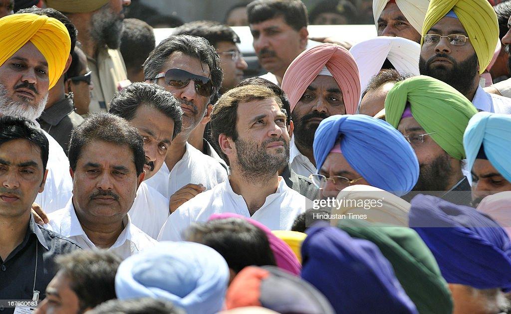All India Congress Committee Vice President Rahul Gandhi during Sarabjit Singh's cremation ceremony at his native village Bikhiwind on May 3, 2013 about 40 Kms from Amritsar, India. Sarabjit Singh, an Indian prisoner in Pakistan who died after being brutally assaulted in a Pakistani jail, was cremated in his native village with full state honours .