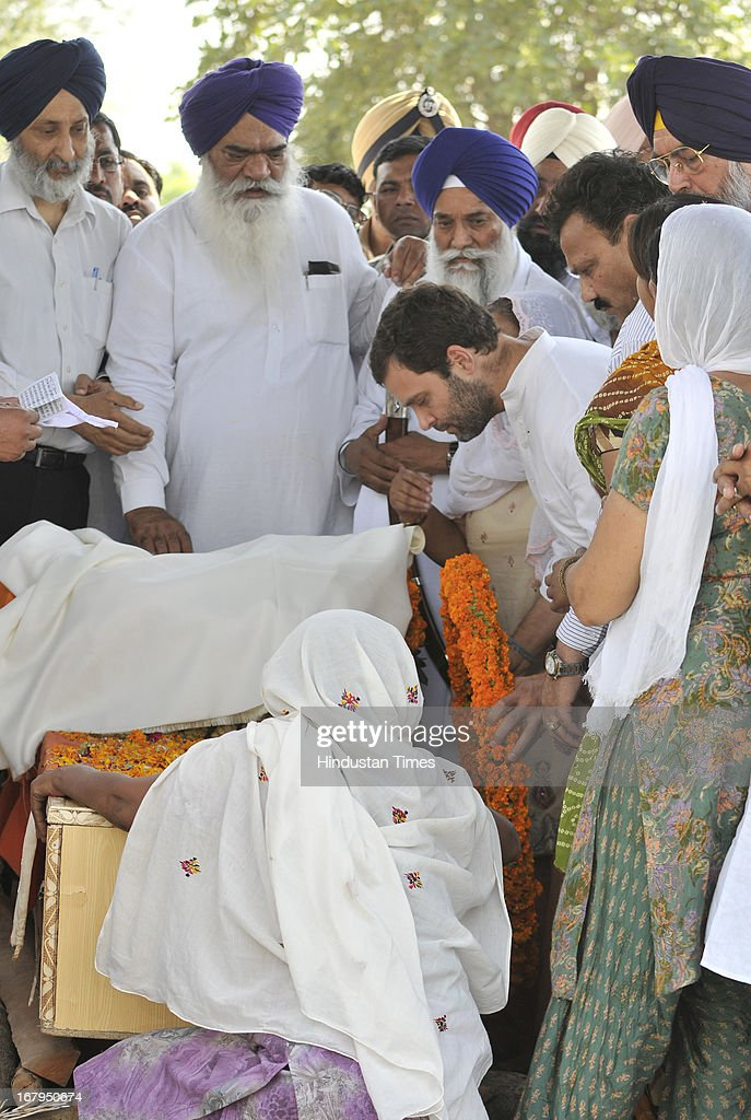 All India Congress Committee Vice President Rahul Gandhi laying the wreath on the pyre of Indian prisoner Sarabjit Singh during his cremation ceremony at his native village Bikhiwind on May 3, 2013 about 40 Kms from Amritsar, India. Sarabjit Singh, an Indian prisoner in Pakistan who died after being brutally assaulted in a Pakistani jail, was cremated in his native village with full state honours .