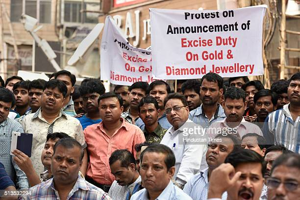 All India Jewellers Swarnkar and Diamond Traders Association shut down all jewellery shops and silently protest against the excise duty declared in...