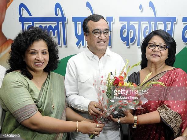 All India Mahila Congress President Shobha Ojha and Delhi Pradesh Congress Committee President Ajay Makan present flower to New Delhi Pradesh Mahila...
