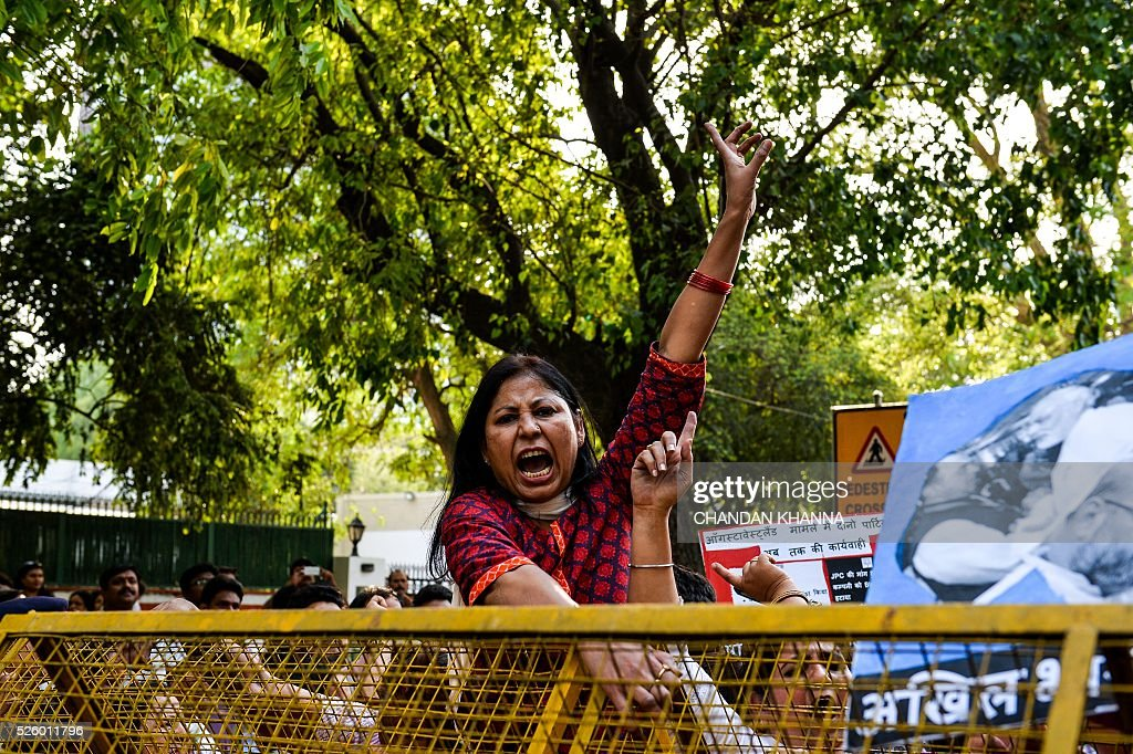 All India Mahila Congress supporters shout slogans as they protest against the ruling Bhartiya Janta Party (BJP) government, accusing them of defaming the All India Congress Party in parliament in New Delhi on April 29, 2016. India's government said April 28 it has asked Britain to extradite British consultant Christian Michel James over a scandal-hit deal the previous government agreed with Anglo-Italian firm AgustaWestland to supply helicopters to Delhi. The deal has set off a fresh political storm in New Delhi after an Italian court reportedly cited James as alleging India's opposition leader Sonia Gandhi and others took more than $27 million in bribes to swing the deal for AgustaWestland. / AFP / CHANDAN