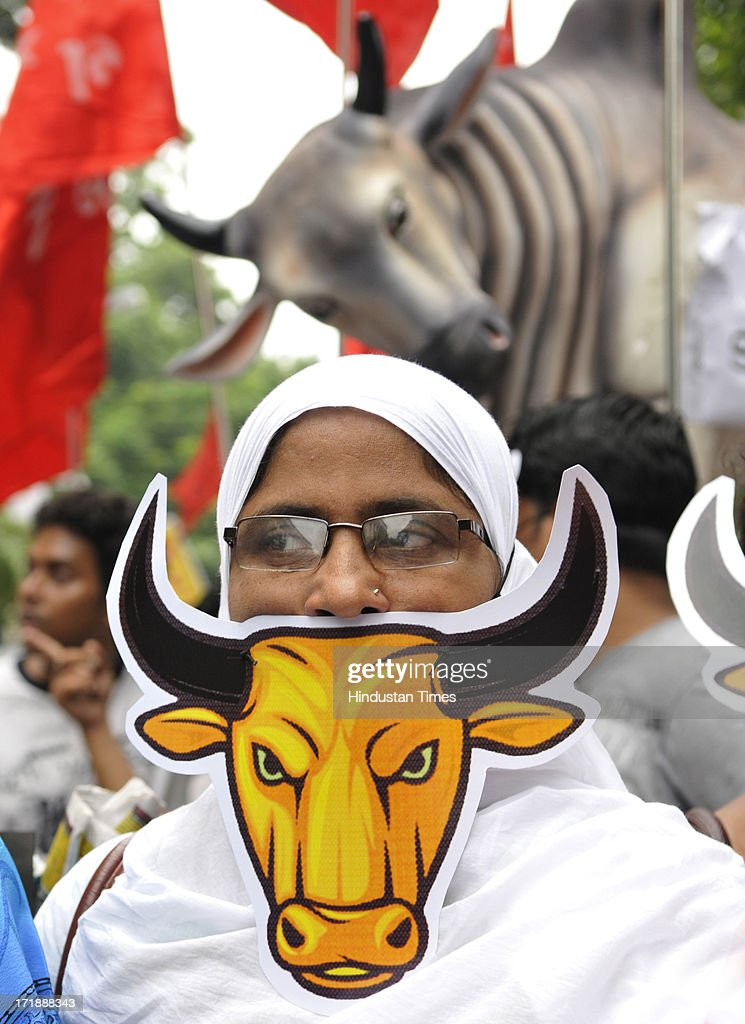 All India Youth League activists wearing the 'Bull Mask' at a protest rally against State Government at College Square on June 29, 2013 in Kolkata, India.