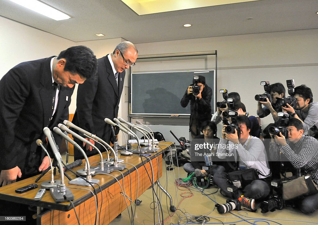 All Japan Judo Federation (AJJF) executives Kiyoshi Murakami (L) and Koshi Onozawa bow for apology at a press conference at Kodokan on January 30, 2013 in Tokyo, Japan. The AJJF admits the allegations that 15 Women's Olympic Judo-ka are subjected to physical punishments by women's national team head coach Ryuji Sonoda and staffs, the judo wrestlers had complained to the Japan Opympic Committee last month. The AJJF has no plan to replace Sonoda.