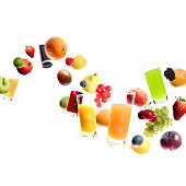 Huge collection  of fruits and juice flying or falling, selective focus, on white background. Studio shot, photo compilation.