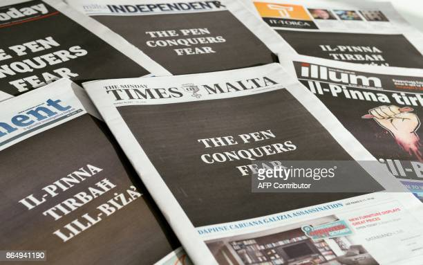 All Maltese newspapers' front pages read in English and Maltese langage 'The Pen Conquers Fear' on October 22 2017 at a newstand in Valletta Malta as...