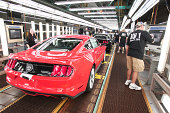 All new 2015 Ford Mustangs are readied to come off the assembly line at the Ford Flat Rock Assembly Plant August 28 2014 in Flat Rock Michigan Ford's...