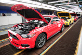 All new 2015 Ford Mustangs go through the assembly line at the Ford Flat Rock Assembly Plant August 28 2014 in Flat Rock Michigan Ford's allnew...