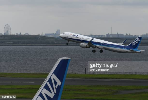All Nippon Airways Airbus A321 aircraft takes off from Haneda international airport in Tokyo on August 2 2017 Japan's All Nippon Airways is expected...