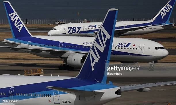All Nippon Airways Co aircraft including a Boeing Co 787 Dreamliner top taxi at Haneda Airport in Tokyo Japan on Tuesday Jan 26 2016 ANA is scheduled...