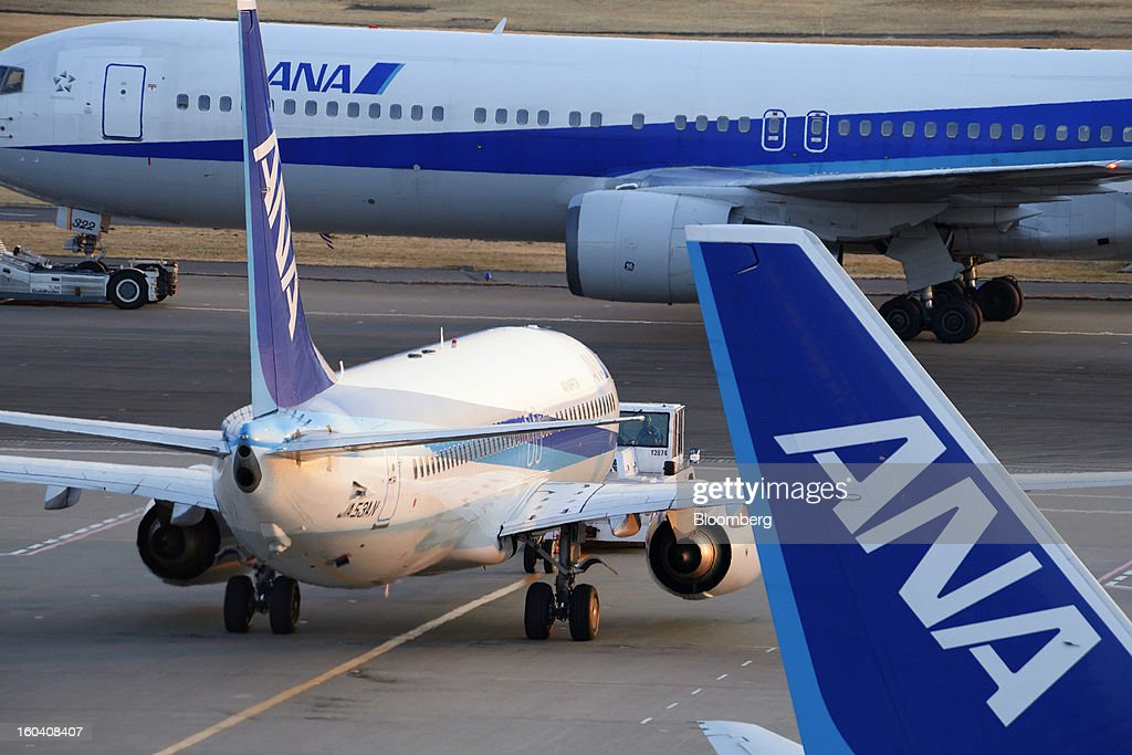 All Nippon Airways Co. (ANA) aircraft stand on the runway at Haneda Airport in Tokyo, Japan, on Wednesday, Jan. 30, 2013. ANA has canceled a total of 784 flights, affecting 74,200 passengers through Feb. 12, since a Jan. 16 incident that led to the global grounding of Boeing Co. 787s, according to figures from the company. Photographer: Akio Kon/Bloomberg via Getty Images