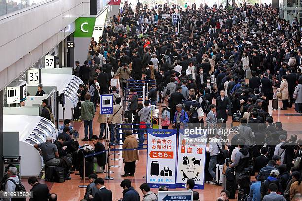 All Nippon Airways counters are packed with passengers at Haneda International Airport on March 22 2016 in Chitose Hokkaido Japan A malfunction in...
