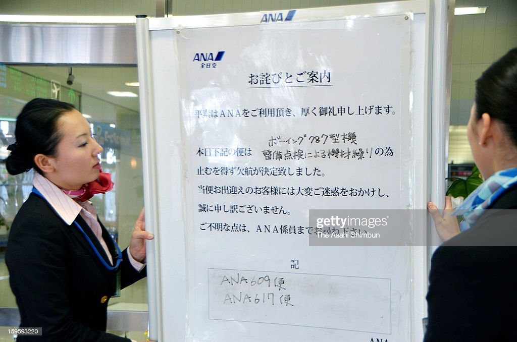 All Nippon Airways ground staffs place a sign to announce the flights using Boeing 787 aircraft will be cancelled at Miyazaki Airport on January 16, 2013 in Miyazaki, Japan. ANA and Japan Airlines (JAL) decided to ground the aircraft until safety secured.