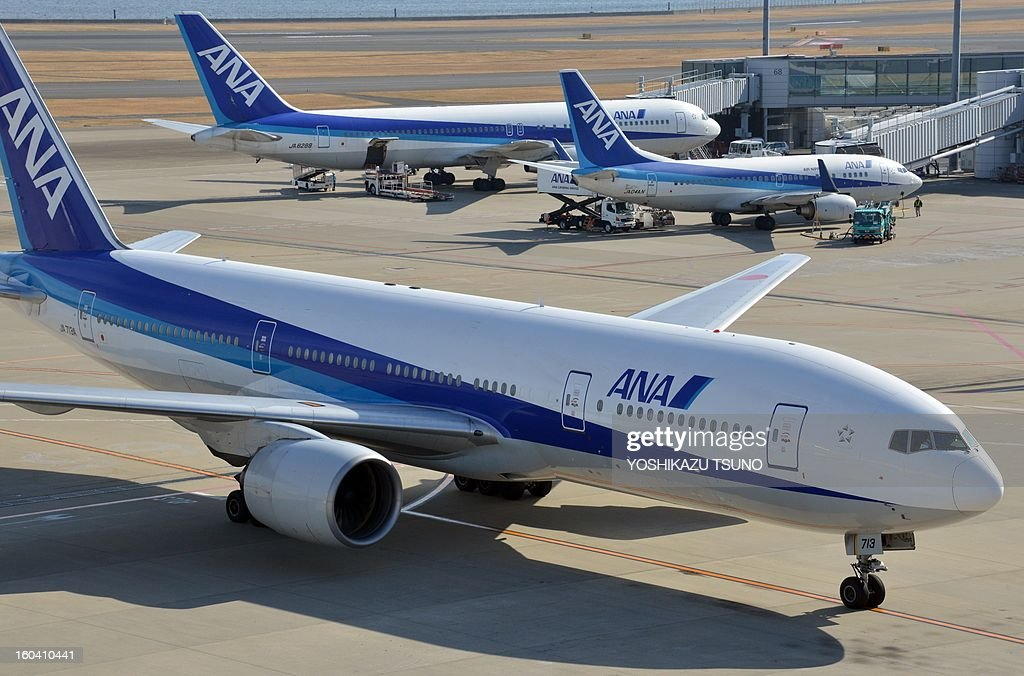 All Nippon Airways (ANA) jetliners sit parked at Tokyo's Haneda airport on January 31, 2013. ANA said its net profit in the nine months to December soared 54.6 percent to 574 million USD, and kept its annual profit forecast, despite its Dreamliner woes. AFP PHOTO / Yoshikazu TSUNO