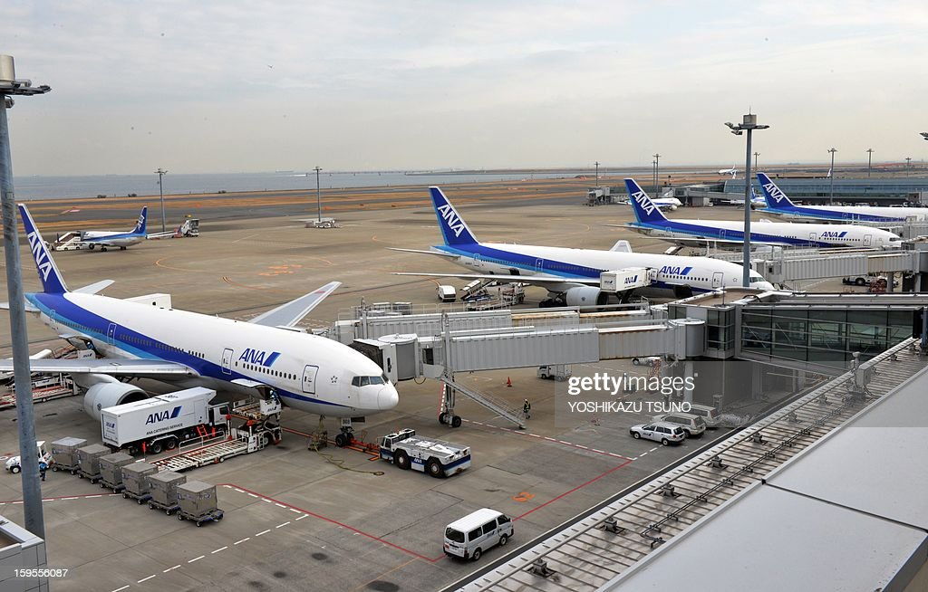All Nippon Airways' (ANA) passenger planes are parked at Tokyo's Haneda airport on January 16, 2013 after a ANA Dreamliner passenger plane made an emergency landing in western Japan after smoke was reportedly seen inside the cockpit. Japan's two biggest airlines on January 16 grounded all their Dreamliners in the most serious blow yet to Boeing's troubled next-generation model after an ANA flight was forced into an emergency landing. AFP PHOTO / Yoshikazu TSUNO