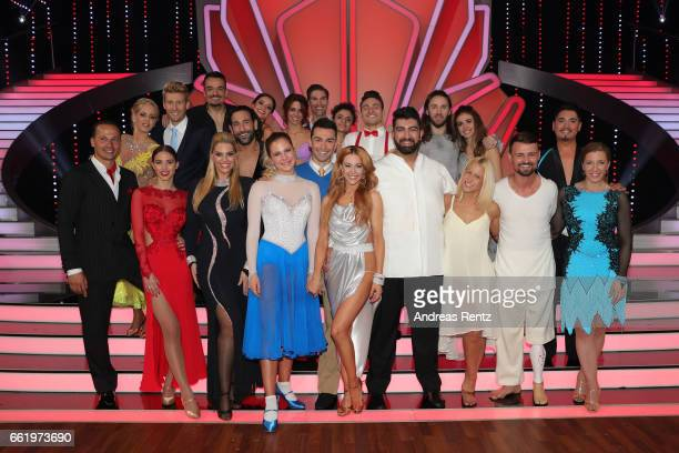 All participants pose for a group photo after the 3rd show of the tenth season of the television competition 'Let's Dance' on March 31 2017 in...