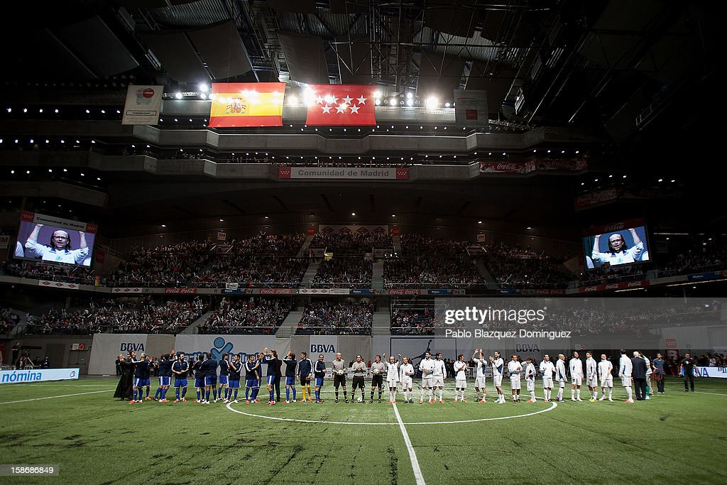 All players stand on the field during 'Partido X La Ilusion' by Iker Casillas Foundation at Palacio de los Deportes on December 23, 2012 in Madrid, Spain.