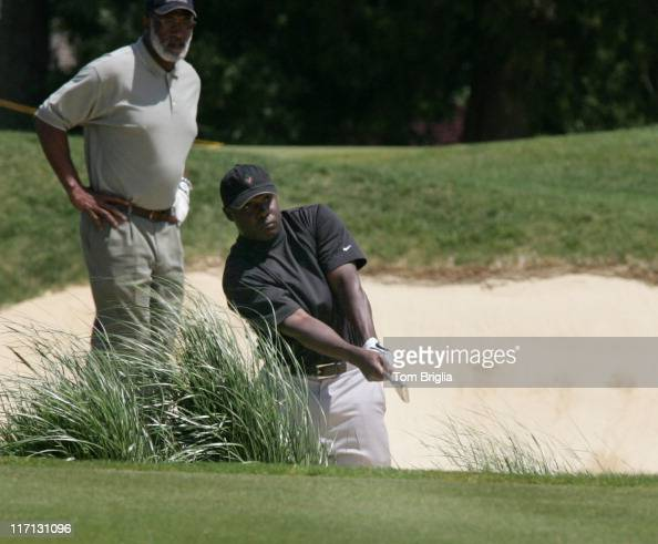 All Pro Running Back two time Super Bowl Champ from the St Louis Rams Marshall Faulk hits out of a trap at the Ron Jaworski Celebrity Golf Challenge...