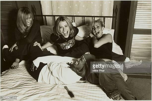 All Saints posed on a bed in a London photographic studio in 1997 LR Melanie Blatt Nicole Appleton Shaznay Lewis Natalie Appleton