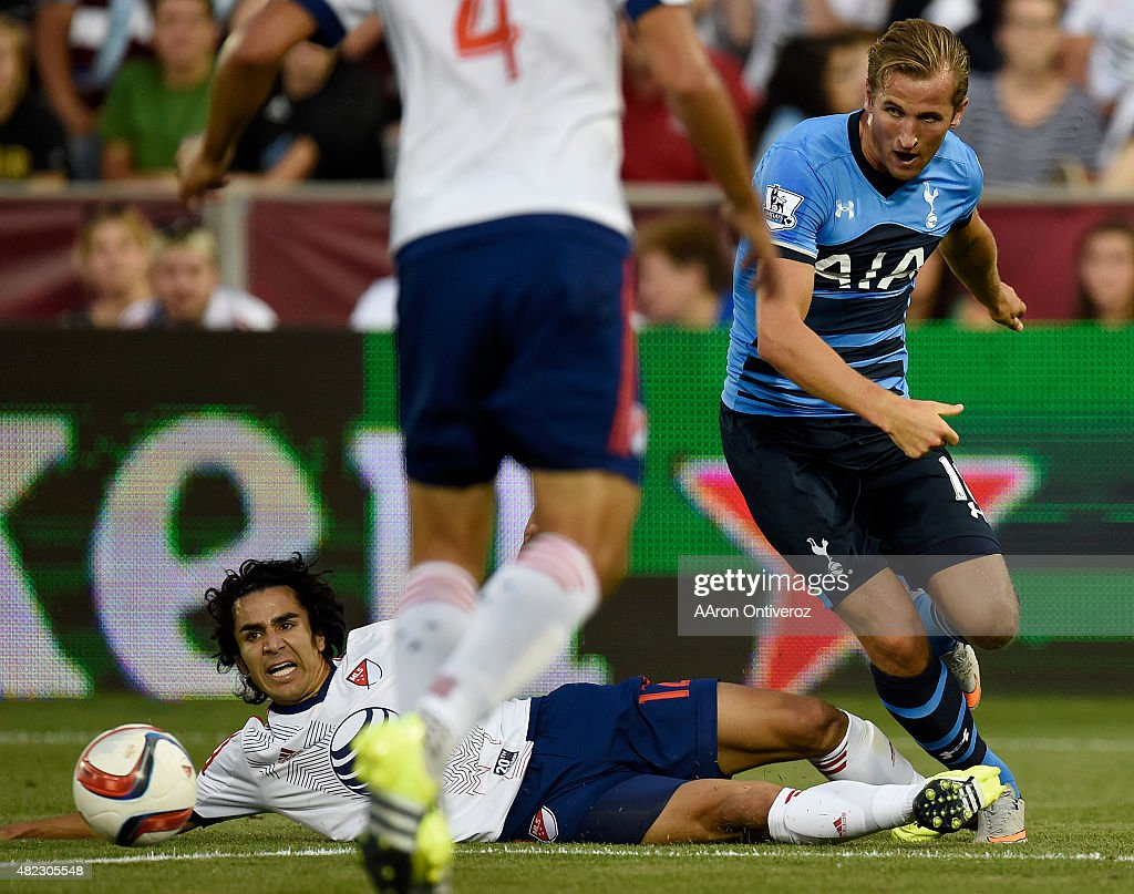 All Star defender Tony Beltran of Real Salt Lake falls to the turf as Tottenham Hotspur forward Harry Kane kicks the ball away during the first half...