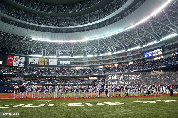 All Star lines up for the national anthem prior to the match during the Game one of Samurai Japan and MLB All Stars at Kyocera Dome Osaka on November...
