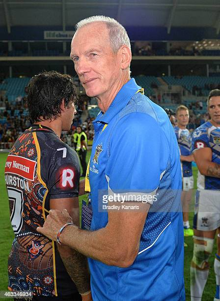All Stars Coach Wayne Bennett congratulates players after the NRL preseason match between the Indigenous All Stars and the NRL All Stars at Cbus...