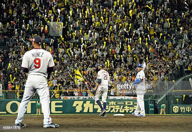 MLB All Stars players watch Japanese baseball fans release balloons in the bottom of 7th inning during the friendly match between Yomiuri Giants...