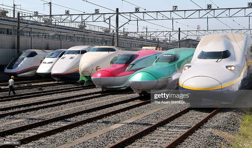 All successive series of Tohoku Shinkansen bullet trains, (L to R) E3 Komachi, E3 Tsubasa, E1 Max, 200, E6, E5 and E4 Max are displayed at JR East's Oyama Shinkansen Train Center on May 19, 2012 in Oyama, Tochigi, Japan.