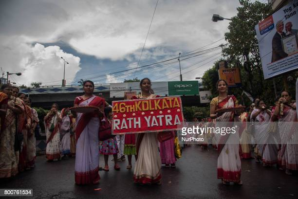 All the devotees are pulling the rope of the chariot with great respect and zealduring Iskon rath yatra in Kolkata India on 2562017Rath Yatra or the...