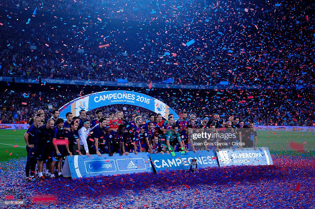 All the F.C.Barcelona players and staff, celebrating the victory, during the F.C.Barcelona vs Sevilla F.C., Spanish Super Cup match, at Nou Camp, on August 17, 2016 in Barcelona, Spain. (Photo by Joan Cros Garcia/Corbis via Getty Images)'n
