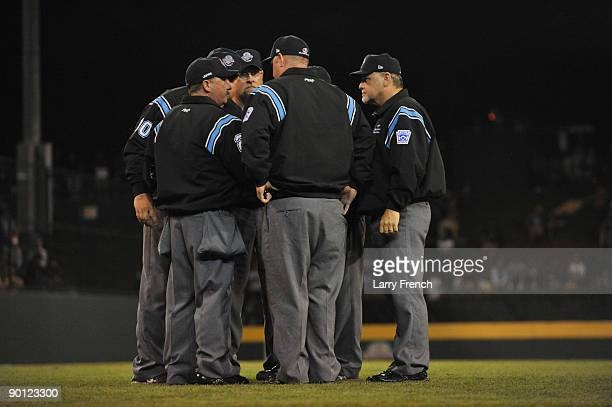 All the umpires confer about a play during the game between the Southeast and the West in the US semifinal at Lamade Stadium on August 27 2009 in...