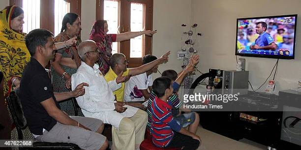 All three generations of family members enjoying India vs Australia Cricket World cup semifinal match on March 26 2015 in Indore India Australia...