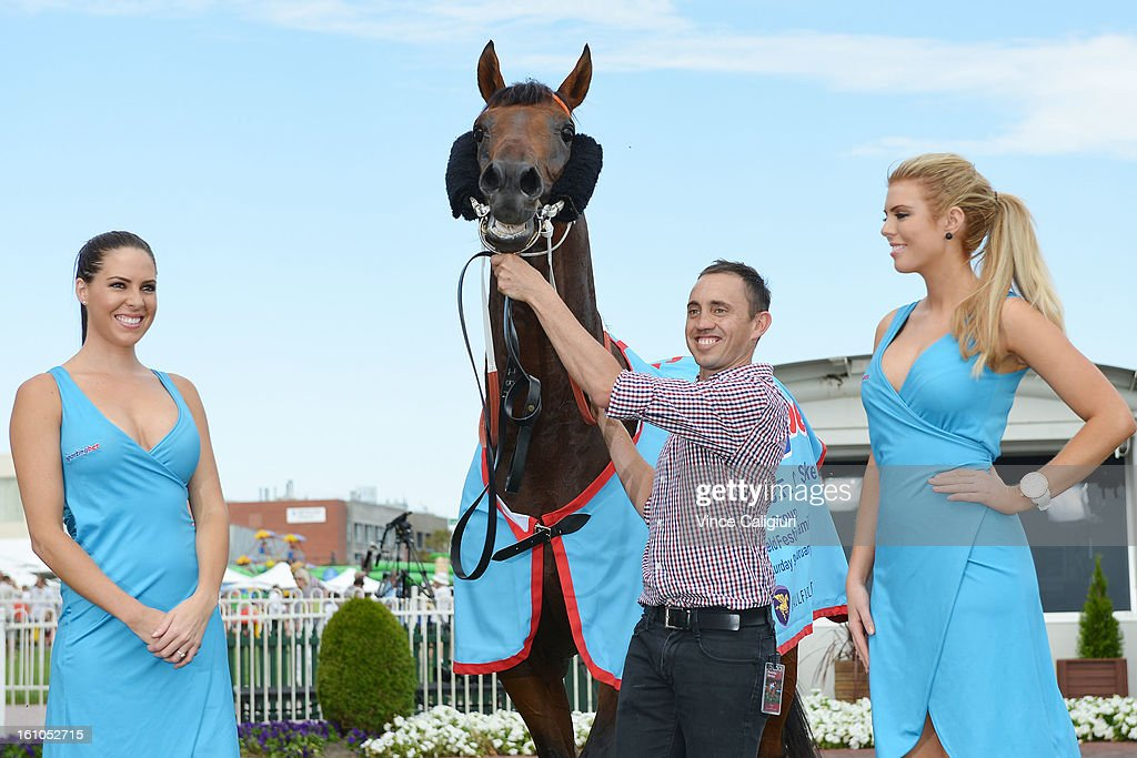 All To Hard posing with Sportingbet girls after winning the Sportingbet C.F.Orr Stakes during Melbourne Racing at Caulfield Racecourse on February 9, 2013 in Melbourne, Australia.