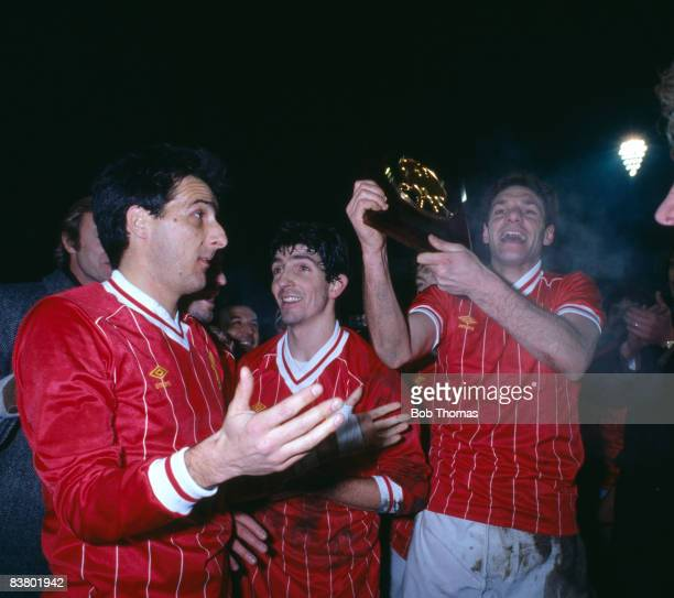 All wearing shirts exchanged with their opponents Juventus players Sergio Brio Paolo Rossi and Gaetano Scirea celebrate with the trophy after they...