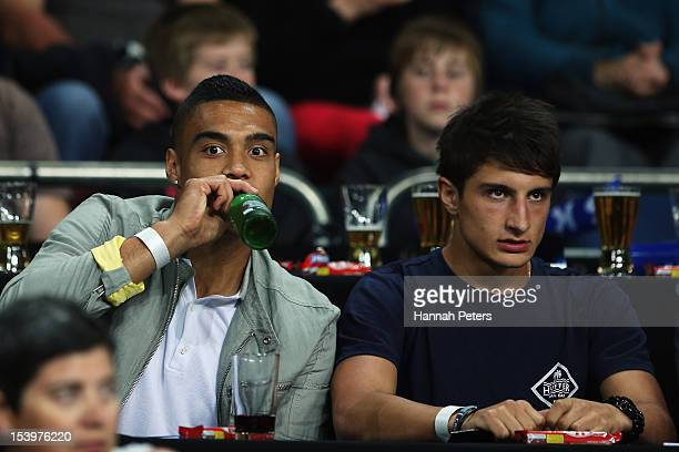 All Whites football player Winston Reid and racing car driver Mitch Evans look on during the round two NBL match between the New Zealand Breakers and...