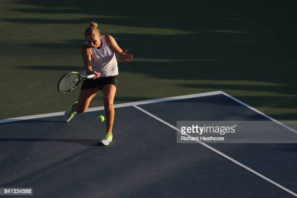 Alla Kudryavtseva of Russia returns a shot against Taylor Johnson and Claire Liu of the United States during their first round Wom on Day Four of the...