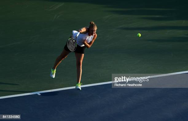 Alla Kudryavtseva of Russia serves against Taylor Johnson and Claire Liu of the United States during their first round Wom on Day Four of the 2017 US...