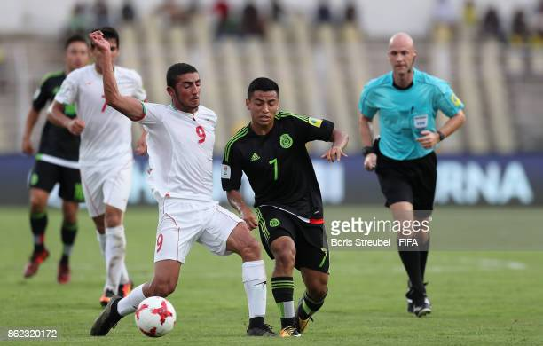 Allahyar Sayyad of Iran is challenged by Jairo Torres of Mexico during the FIFA U17 World Cup India 2017 Round of 16 match between Iran and Mexico at...
