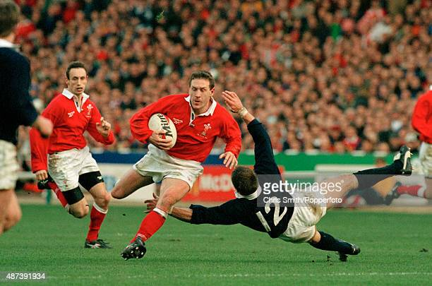 Allan Bateman of Wales evades Scotland's Gregor Townsend during the Five Nations Rugby Union International match between Scotland and Wales at...