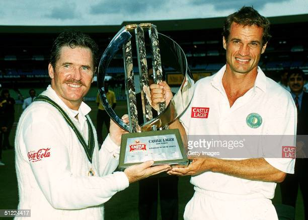 Allan Border of Australia and Kepler Wessells of South Africa hold aloft the winners trophy during the 3rd Test Match between South Africa and...
